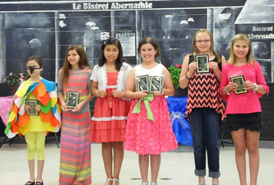 Hale County 4-H'ers Athena Pereria (left), Kyrstn Rexrode, Kristin Ortiz, Berkley Carver, Kylee Patterson and Carly Taubert display their Fashion Show plaques