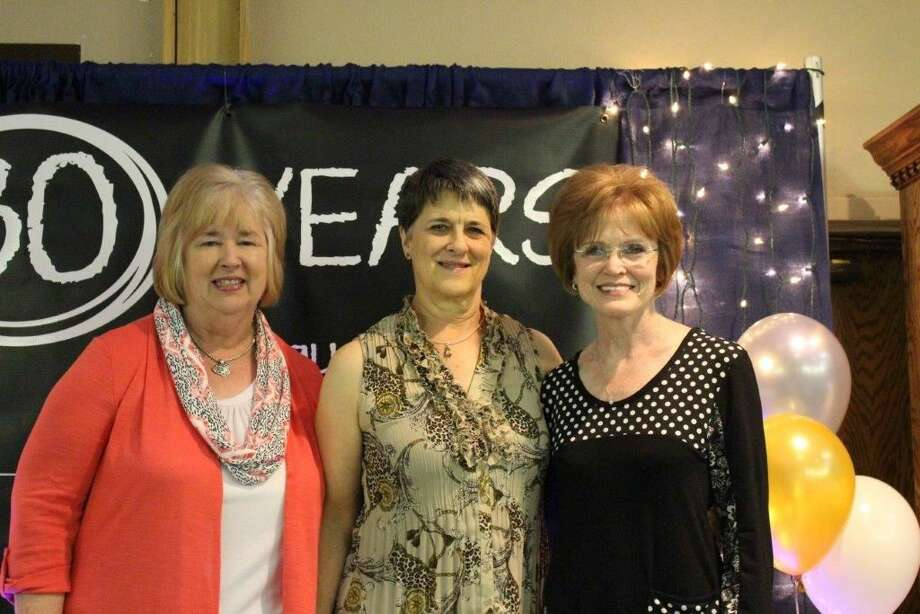 Longtime Plainview Christian Academy staff members Pam Hinze (left), Karla McDonald and Sue Turner were recognized Friday during the school's annual fundraising auction. Among its longest-tenured teachers, Hinze and Turner were among the school's founders and all three have been a part of the school from its earliest days.