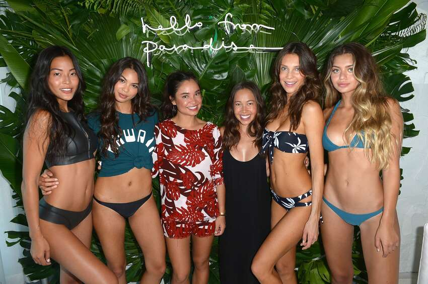 Designers Oleema Miller and Kalani Miller (C) pose with models at MIKOH 2017 Collection at Miami Swim Week at 1 Hotel South Beach on July 17, 2016 in Miami, Florida.