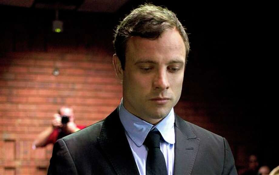 "File - In this file photo taken on Monday, Aug, 19, 2013, Paralympic athlete Oscar Pistorius appears at the magistrates court in Pretoria, South Africa. Oscar Pistorius' murder trial will have a dedicated 24-hour television channel in South Africa, the country's top cable provider said, Wednesday, Jan. 29, 2014, promising ""round-the-clock"" coverage of one of the blockbuster stories of the year. (AP Photo/Themba Hadebe, File) Photo: Themba Hadebe / AP"