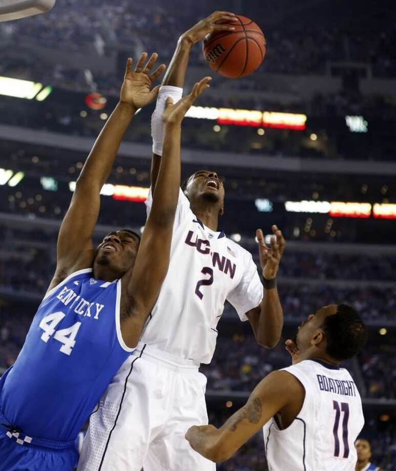Kentucky Wildcats center Dakari Johnson (44) loses control of the ball to Connecticut Huskies forward DeAndre Daniels (2) in the first half as the Kentucky Wildcats faced the Connecticut Huskies in the NCAA Final Four championship game at AT&T Stadium in Arlington Monday. Photo: Vernon Bryant/Dallas Morning News/MCT