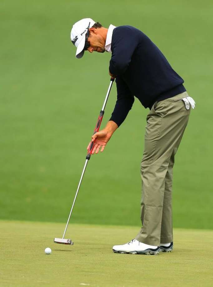 Defending champion Adam Scott putts for a birdie on the No. 2 green during his practice round for the Masters at Augusta National Golf Club Tuesday. Photo: Curtis Compton/Atlanta Journal-Constitution/MCT