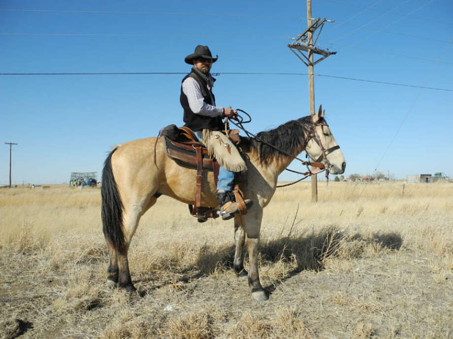Gail M. Williams/Plainview HeraldWinston Hall pauses on his 1,000 mile journey from Gatesville, Texas, to Wind River Ranch near Estes Park, Colo., in honor of his friend Jonathan Avitia. The horse, Durango Bobwire, is a 4-year-old American Mustang.