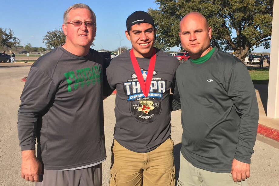 Floydada powerlifter Aaron Chavarria (center) won the state championship in the Division 3, 220-pound weight class at Abilene Saturday. Flanking Chavarria are Floydada athletic director and assistant powerlifting coach Todd Bandy (left) and powerlifting head coach Coby Emery (right). Photo: Courtesy Photo
