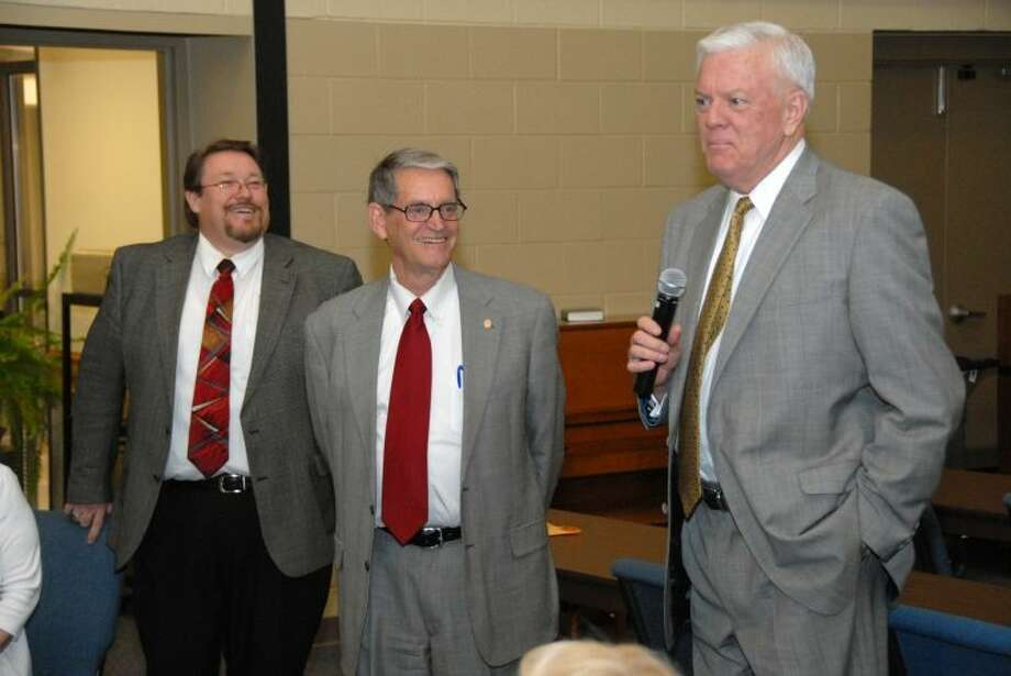 Wayland Baptist University President Dr. Paul Armes (right) says a few words about Dr. Kent Brooks (center) during his retirement reception at the Wayland Baptist University Lubbock campus. Brooks is retiring after 29 years of service to the school. Also pictured is campus Executive Director Dr. David Bishop.