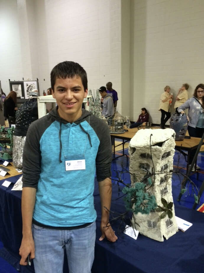 """Courtesy PhotoHale Center ISD'S Jesus Alvidrez shows off his sculpture """"Revenge of the Trees"""", which took the Gold Seal at the V.A.S.E State art competition in Bryan, Texas. Three Hale Center students advanced to the state level at the event. Marcos Alvidrez and James Castle both received an Excellent rating while Jesus Alvidrez received an Distinguished rating. Only 152 entries out of the 26,000 entries from across the state were given this Gold Seal Medal. All 152 pieces of art will spend the next six months traveling the state for exhibition (including the Texas Capitol)."""