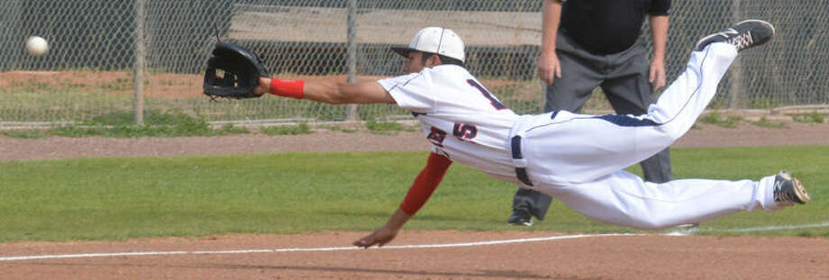 Plainview third baseman Ryan Deleon dives for a ball in the first inning of a District 4-4A game against Lubbock Monterey at Bulldog Field Friday. Monterey came back to win the game, 7-3. Photo: Skip Leon/Plainview Herald