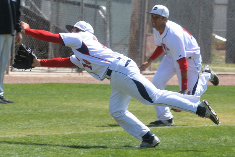 Plainview pitcher Brent Silvas makes a diving attempt to catch a bunt that was popped up in the first inning of a non-district baseball game against Frenship at Bulldog Park Friday. Photo: Skip Leon/Plainview Herald