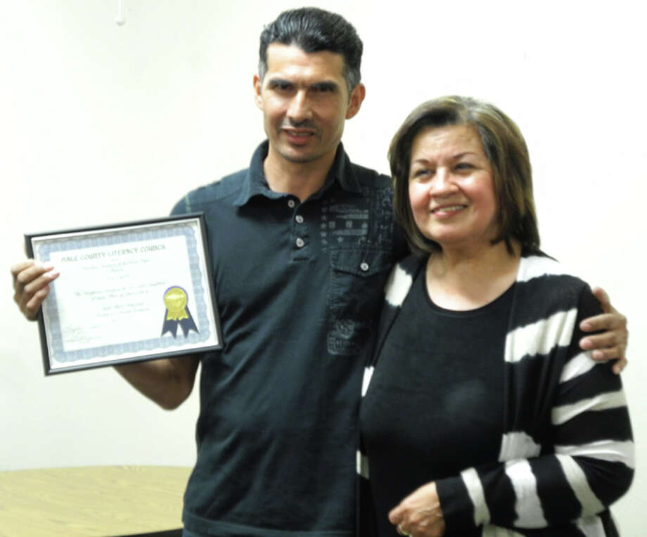 Jose Carrillo accepts an award certificate from Hale County Literacy Director Lydia Castillo. Carrillo completed 465.28 hours, more than any other student in the ABE/ESL classes funded by a grant from Workforce Solutions. Photo: Gail M. Williams | Plainview Herald