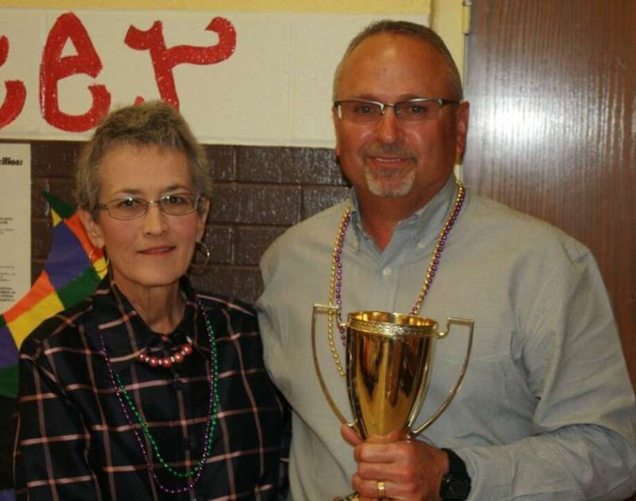 Phil Cotham was recognized as the 2013 Lockney Chamber of Commerce Citizen of the Year. Kay Martin, one of the 2012 recipients, presented Cotham with his trophy. Photo: Courtesy Photo