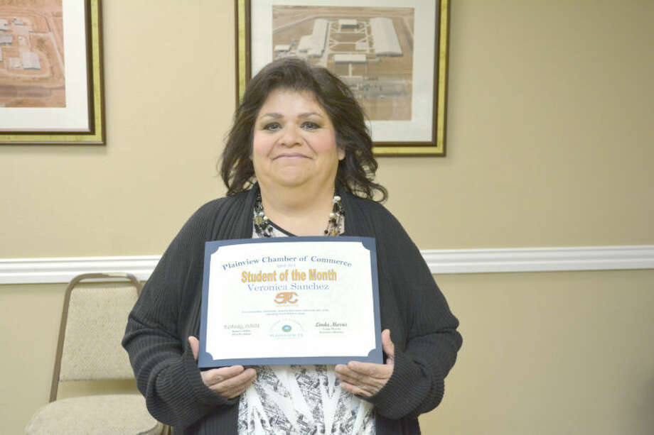Doug McDonough/Plainview HeraldVeronica Sanchez, a single mother of four, is the Chamber of Commerce Student of the Month for April. Listed as a freshman at South Plains College, she is a 20-year veteran associate with the Wal-Mart Distribution Center. She is a full-time student during the day and works part time at night, studying toward a degree in sociology. Sanchez plans on becoming either a counselor or youth social. A member of the Phi Theta Kappa Honor Society, she serves as bilingual teacher at College Heights Baptist Church. She enjoys spending time with her children, three sons ages 7, 11 and 13, and a daughter age 20 who has a 17-month-old daughter.