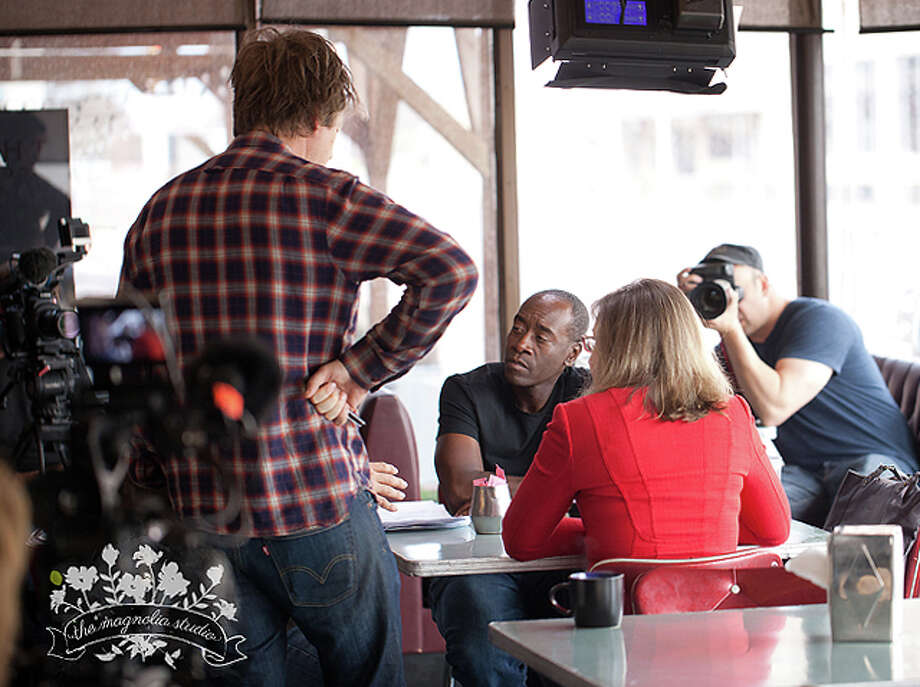"Actor Don Cheadle sat down with Dr. Katharine Hayhoe of Texas Tech to talk about climate change Tuesday at The Broadway Brew. Cheadle is a celebrity interviewer for Showtime's eight-part documentary, ""Years of Living Dangerously."" Photo: Courtesy Photo/The Magnolia Studio"