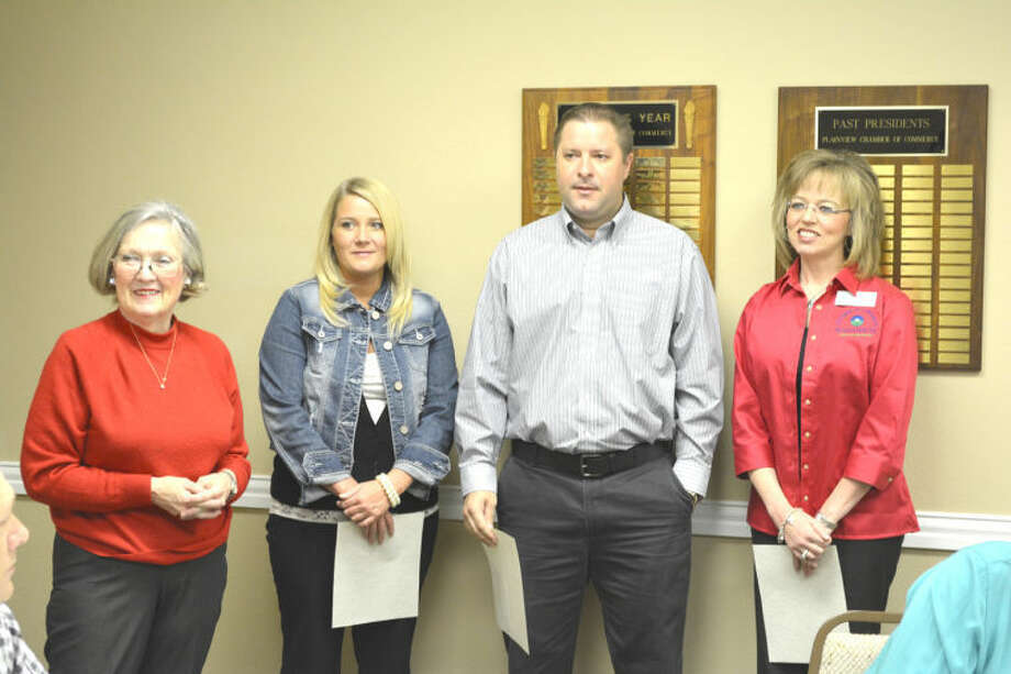 Doug McDonough/Plainview HeraldChamber Ambassadors Committee Chair Janice Payne (left) honors the three Chamber Ambassadors of the quarter, Athena Stennett, Brandon Ahrens and Denise Smith. The honor is based on a point system that resulted in a three-way tie.