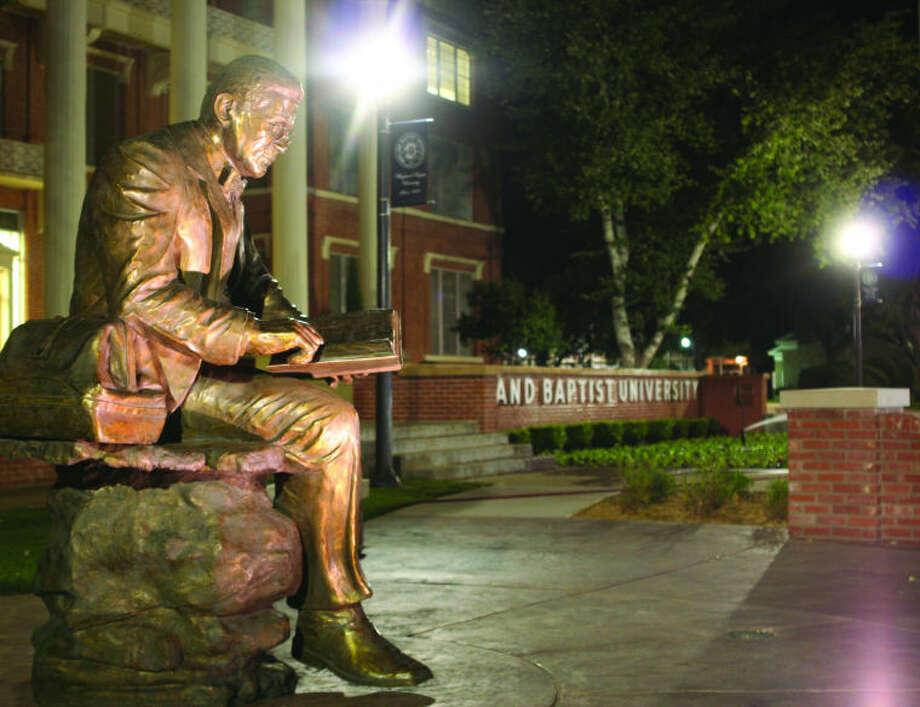 Wayland Baptist University PhotoA statue of Dr. James Henry Wayland, founder of Wayland Baptist University, dominates Heritage Plaza outside of Gates Hall. Inset is a portrait of Dr. Wayland.