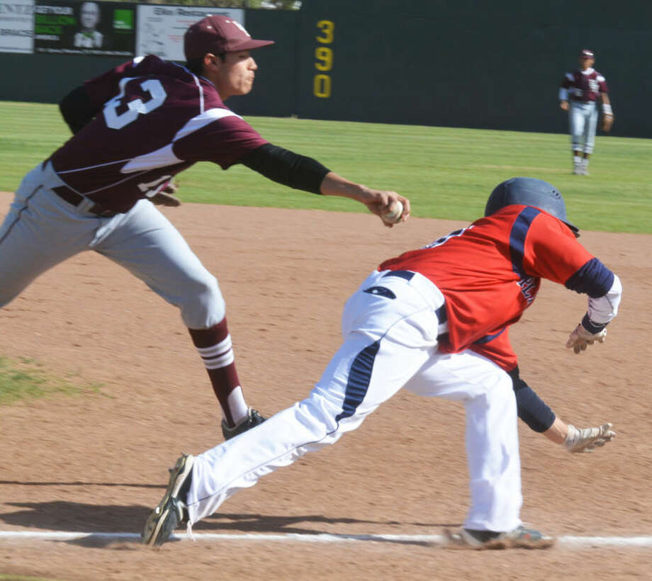 Plainview's Brent Silvas avoids the tag of Hereford first baseman Tim Sanchez to reach base safely in the first inning of a District 4-4A baseball game at Bulldog Park Tuesday. The Bulldogs won the contest, 9-0. Photo: Skip Leon/Plainview Herald