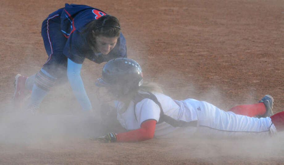 Plainview's Anna Moreno dives back to third base ahead of the tag of the Lubbock Monterey third baseman in a District 4-4A game at Lady Bulldog Park Tuesday. Moreno had just hit a three-run triple. She drove in four runs overall as Plainview hammered Monterey 15-2. The Lady Dogs are in second place in the district with one game remaining. Photo: Skip Leon/Plainview Herald