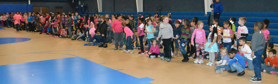 Students at Akin Elementary in Hale Center stand to signify that they participated in the fundraiser for the Kay Yow Cancer Fund. The 166 students who participated collected more than $11,000, which was the most of any elementary, middle or high school in the nation. They won a national award which was accepted by physical education teacher Linda Pshigoda at an event in Tampa, Fla., Friday. Photo: Skip Leon/Plainview Herald