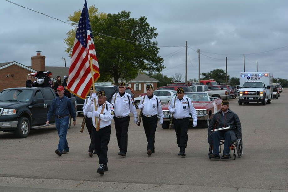 Lockney's American Legion Post 141 Color Guard is at the front of a recent parade in Lockney. Shown with flag bearer Ed Marks are Color Guard members Mike O'Connell, Sam Moore, Greg Patridge, Jim Doucette, Marco Martinez and David Gary in the wheelchair.