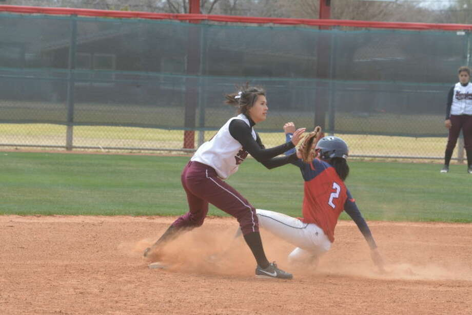 Plainview's Criselda Luna (2) steals second base as Hereford shortstop Mia Castaneda awaits the late throw during a softball game earlier this season. Luna was 3-for-3 with two doubles, two runs scored and a run batted in as the Lady Bulldogs beat San Angelo Lake View Friday, 8-5, in the final District 4-4A game of the season to clinch the district's runner-up spot with an 8-2 record. Luna also was the winning pitcher with five innings of work. Photo: Skip Leon/Plainview Herald