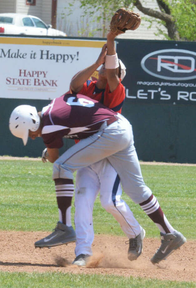 Hereford's Payton Gonzales (6) runs into Plainview shortstop Danny Martinez as he tries to catch a popup in the sixth inning Friday. The ball dropped, but the runner was called out on the play for interfering with the fielder. Photo: Skip Leon/Plainview Herald