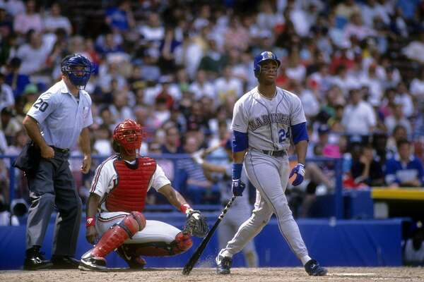 CLEVELAND, OH - CIRCA 1990: Outfielder Ken Griffey Jr. #24 of the Seattle Mariners swings and watches the flight of his ball against the Cleveland Indians circa 1990 during a Major League Baseball game at Cleveland Stadium in Cleveland, Ohio. Griffey played for the Mariners from 1989-99 and 2009-2010. (Photo by Focus on Sport/Getty Images)