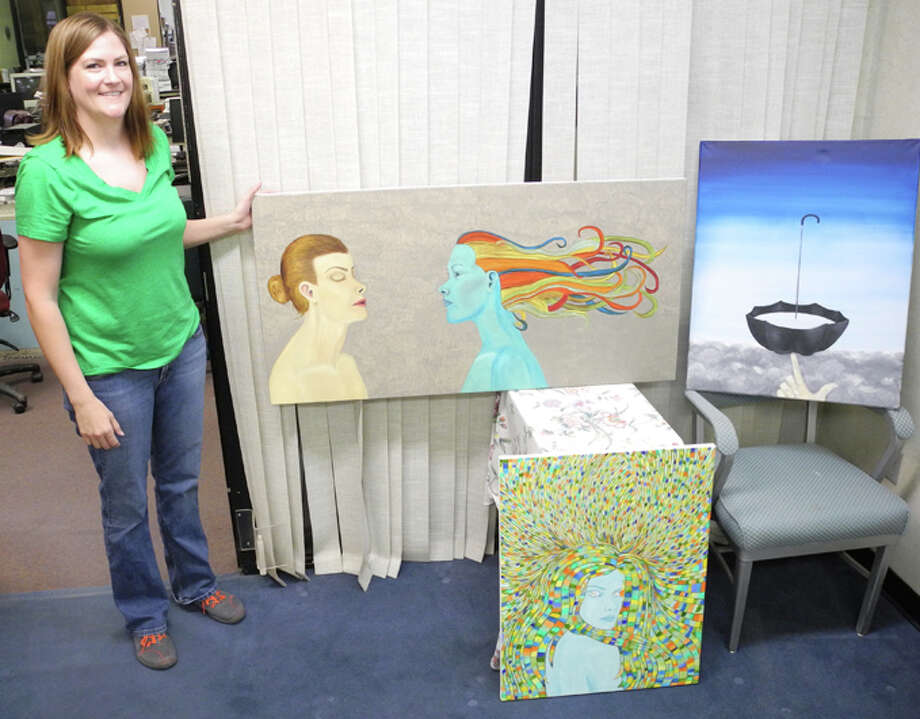 Until a year and a half ago, Robyn Barrett had never tried painting. Now she paints 10 to 12 hours a day, four days a week. Her works will be on display at Artwalk Plainview on Friday. Photo: Gail M. Williams | Plainview Herald