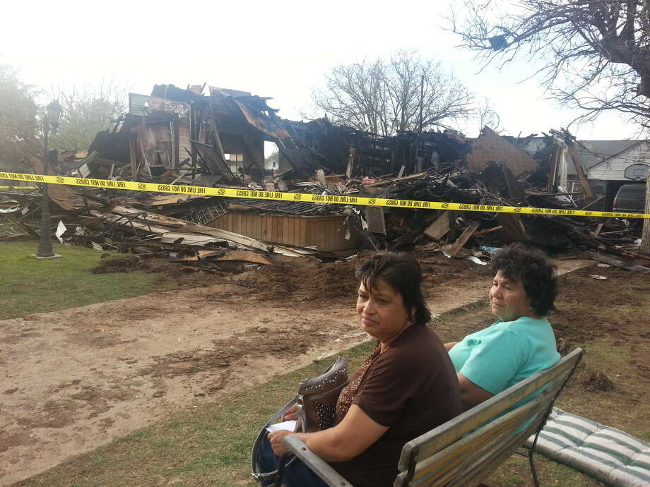 Genie Soto, left, and her mother, Juanita Garcia, survey the remains of Soto' s house at 712 W. Ninth St. that burned down Wednesday afternoon. The fire, the second one within 30 minutes in Plainview, was reported on the second floor of the residence. No one was injured, but the home was a complete loss. Photo: Photo By Dr. Charles Starnes