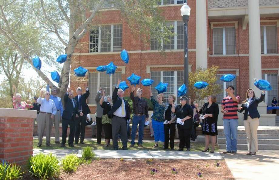 Wayland Baptist University PhotoWayland Baptist University and community representatives join to commemorate the 151st birthday of Dr. James H. Wayland on Tuesday in front of Gates Hall. Individuals representing various community and Wayland groups who released balloons are Linda Adkins (left), Dr. Wayland's granddaughter; Bill Lees, grandson; Plainview Mayor Wendell Dunlap; Hale County Judge Bill Coleman; Dr. Paul Armes, Wayland president; Kevin Carter, Hale County Economic Development Corp.; Linda Morris, Chamber of Commerce; Danny Andrews, Wayland alumni; Rodney Watson, Hale County Historical Society; Jeanine Shackelford, Wayland staff; Peggy Wall, Wayland trustees; Dr. Estelle Owens, Wayland faculty; Dr. Elane Seebo, WBU external campuses; Carlos Busitllos, WBU students; and Miss Wayland Nicole Adams.
