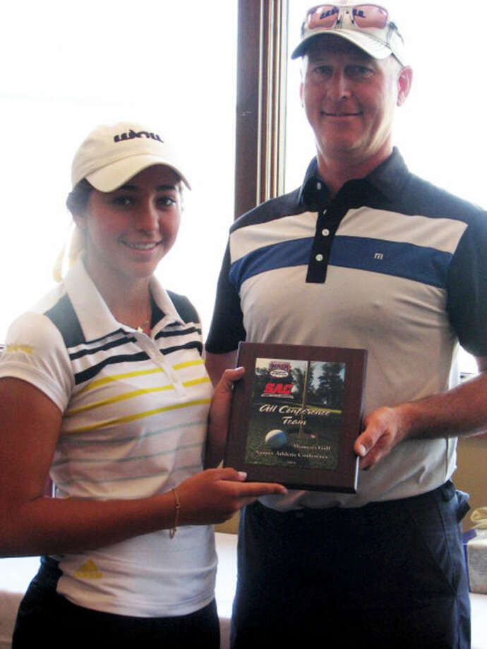Wayland Baptist University's Natalia Ugalde (left) is presented with her All-Sooner Athletic Conference plaque by head coach Tom Harp after her performance at the SAC Tournament Monday and Tuesday. Photo: Wayland Baptist University Photo