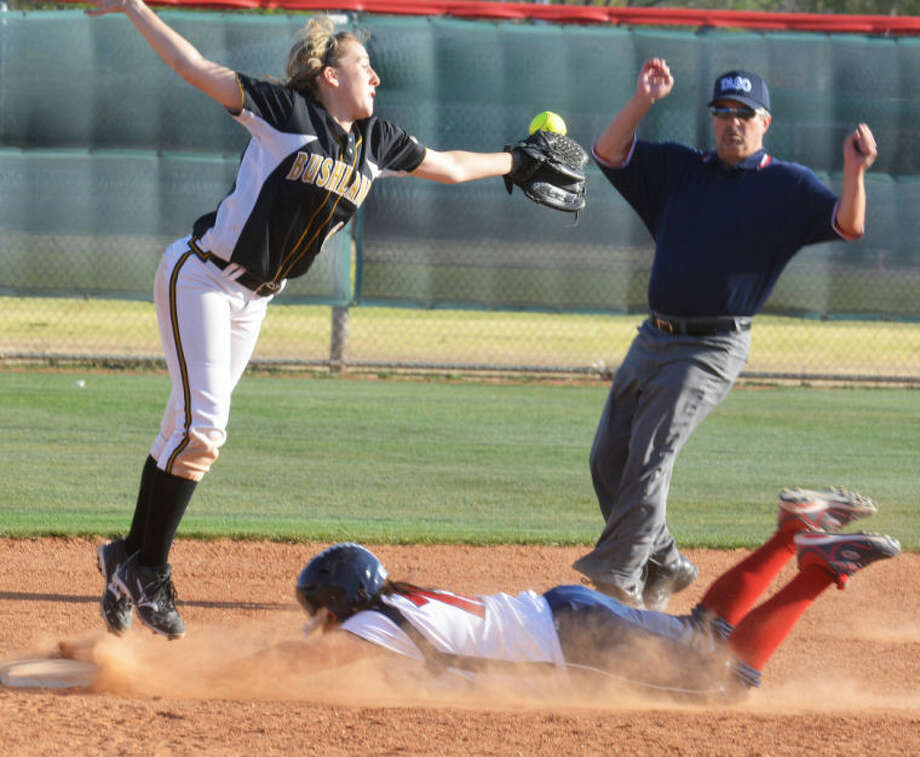 Plainview's Chyane Hernandez dives into second base as the ball gets past the Bushland second baseman in the seventh inning of a non-district game at Lady Bulldog Park Tuesday. Bushland won the game, 5-1. Photo: Skip Leon/Plainview Herald