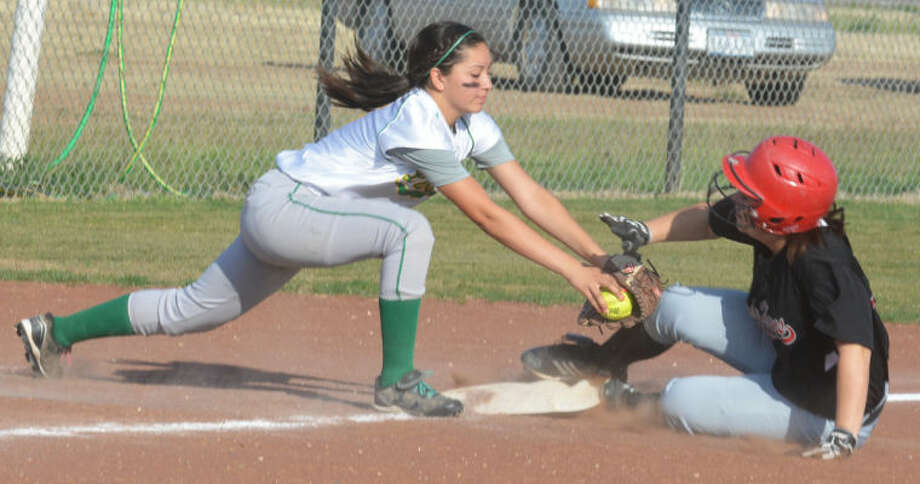 Lockney's Darby Long slides into third base just ahead of the tag by the Idalou third baseman in the fourth inning of a tuneup game for the playoffs at Lockney Monday afternoon. The Lady Longhorns won the game, 11-8. Photo: Skip Leon/Plainview Herald