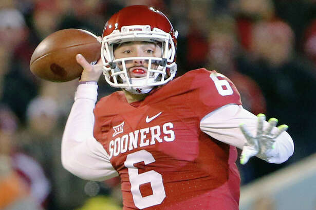 In this Nov. 21, 2015, file photo, Oklahoma quarterback Baker Mayfield (6) looks to pass against TCU during the first quarter in Norman, Okla. Oklahoma quarterback Baker Mayfield is the unanimous pick as the Big 12 offensive player of the year and one of seven Sooners on the Associated Press All-Big 12 first team.