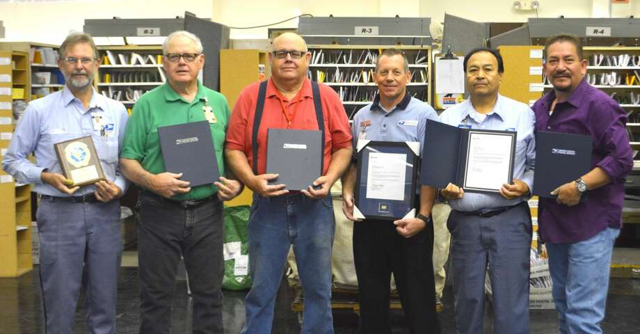 Postal HonoreesDoug McDonough/Plainview HeraldSix local postal workers were recognized Friday with various longevity awards. Roger Stambaugh (left), who joined the U.S. Postal Service in 1974, is now a member of the 1 Million Mile Club for 30 years of safe driving without a traffic mishap. Brothers Gary and Tommy Louthan each received awards for 25 years of service; Brad Clark, 35 years; Robert Chavez, 30 years; and Robert A. Garcia, 30 years.