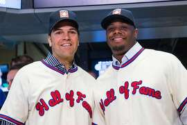 Former Major League Baseball players Mike Piazza (L) and Ken Griffey Jr. pose for a photo after ringing the opening bell at the New York Stock Exchange on the morning of January 8, 2016 in New York City. Piazza and Griffey were elected to the Baseball Hall of Fame.  (Photo by Andrew Burton/Getty Images)