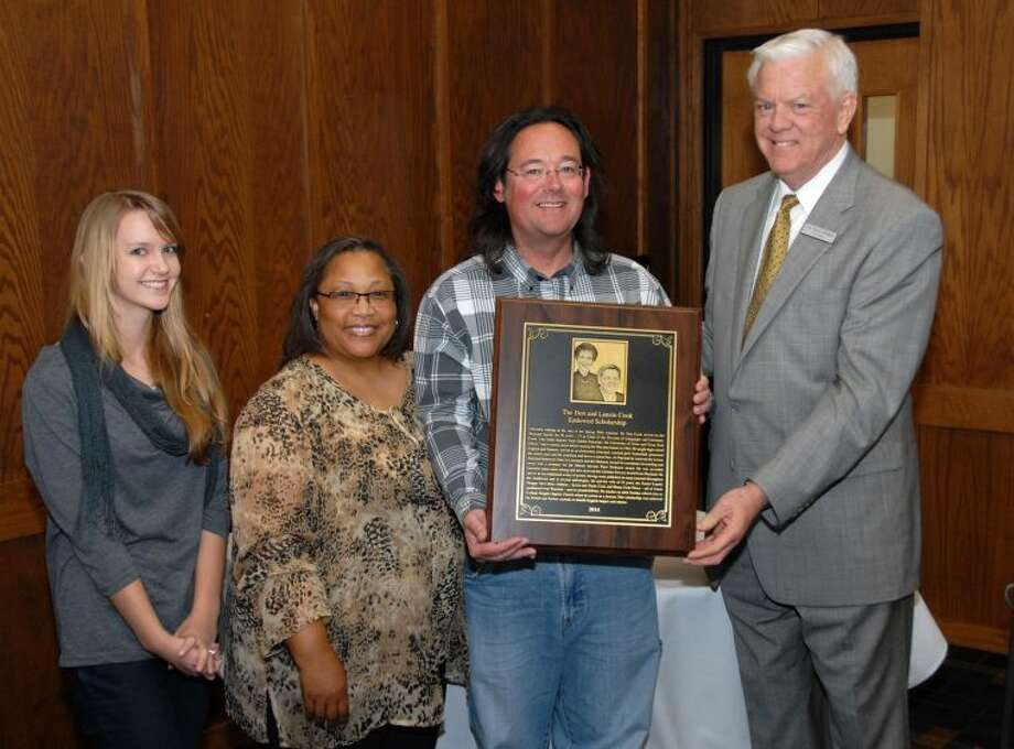 Wayland Baptist University Photo Members of Wayland Baptist University's Board of Trustees recognized the family of Dr. Don and Lannie Cook, dedicating an endowed scholarship in their name Thursday afternoon during the luncheon at the Trustees meeting. Don and Lannie could not attend the luncheon, but family members Bridget Pierce (from left) and Sallie and Kevin Cook were on hand for the unveiling of the scholarship plaque by Wayland President Dr. Paul Armes.
