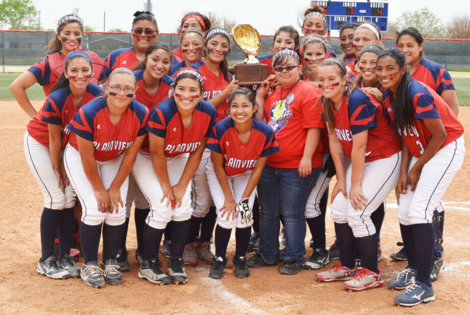 The Plainview Lady Bulldogs pose with the bi-district championship trophy they earned with a 5-4 victory over Dumas at Lady Bulldog Park Saturday afternoon. Plainview will play either El Paso Chapin or El Paso Eastlake in the area round this week. Photo: Skip Leon/Plainview Herald