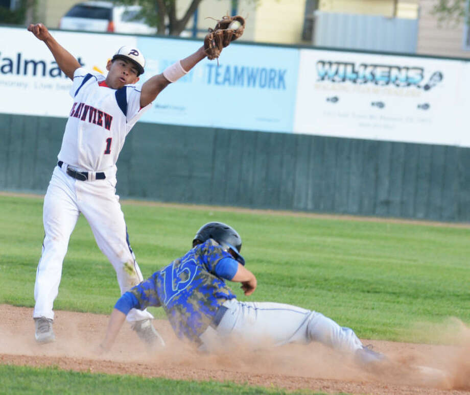 Plainview shortstop Danny Martinez leaps to take a pickoff throw as a Frenship runner slides safely back to second base during the Bulldogs' District 4-4A game at Bulldog Park Friday. Photo: Skip Leon/Plainview Herald