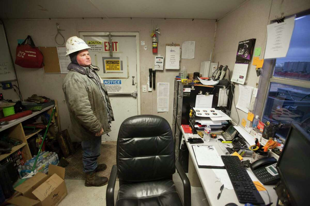 Randy Perry, a crew manager who oversees drilling for Elevation Resources, at his office near Midland, Texas, Jan. 14, 2015. With oil prices plummeting by more than 50 percent since June, the gleeful mood of recent years has turned glum here in West Texas as the frenzy of shale oil drilling has come to a screeching halt (Michael Stravato/The New York Times)