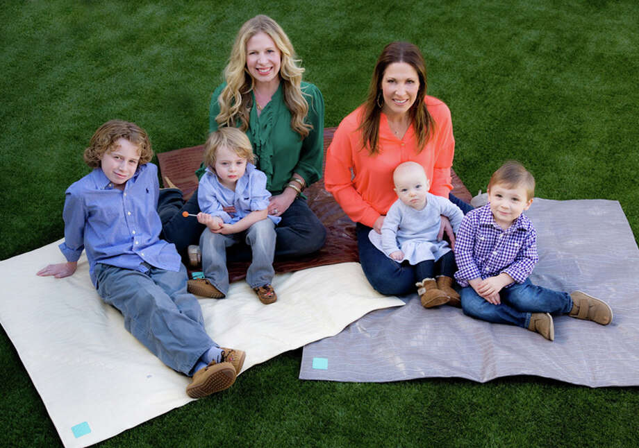 Kelly Teague Smith, left, and Emily Jones McCoy with their children, ranging in age from 6 months to 9 years - four great reasons to invent the Posh Play Mat and the Posh Play Pad. Photo: Courtesy Photo | Posh Play / photo © jill johnson