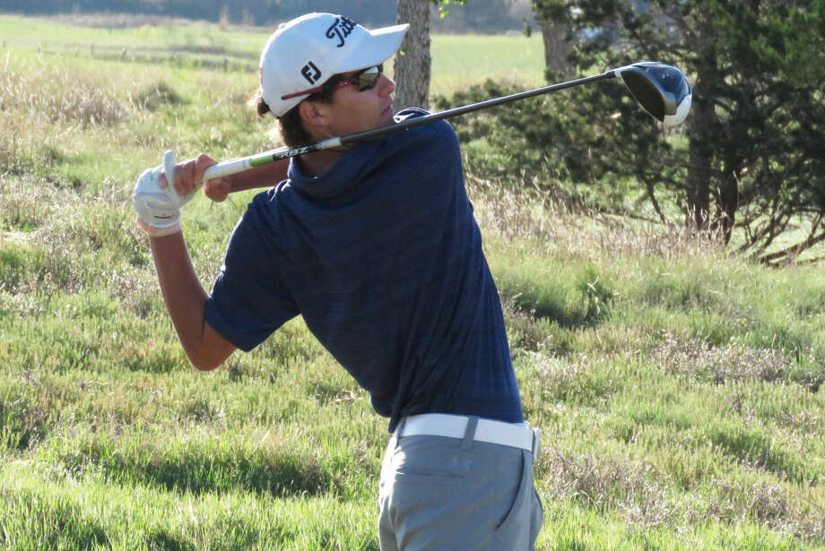 Plainview's Ryan Edwards follows through on a swing during the Region 1-5A Golf Tournament at the Rawls Course in Lubbock Wednesday. Edwards, the only senior on the team, was playing in his final high school golf event. The Bulldogs finished 10th as a team. Photo: Photo Courtesy Of Betsy Lewis