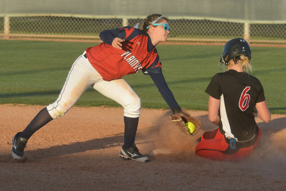Plainview shortstop Morgan Chapa reaches to tag a Lubbock Cooper runner during a District 4-5A softball game at Lady Bulldog Park Wednesday. Chapa doubled in what proved to be the deciding run as the Lady Bulldogs handed Cooper their first district loss of the season, 5-4. Photo: Skip Leon/Plainview Herald