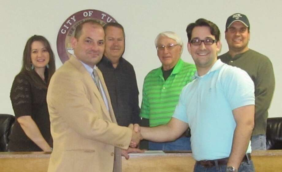 Courtesy PhotoParticipating in the announcement of a contract between the Tulia Economic Development Corporation and Texas Communities Group, LLC, were Amy McAtee (left), Danny Barrett, Ross James, Pat George, Andrew Freeman and Joshua Moore.