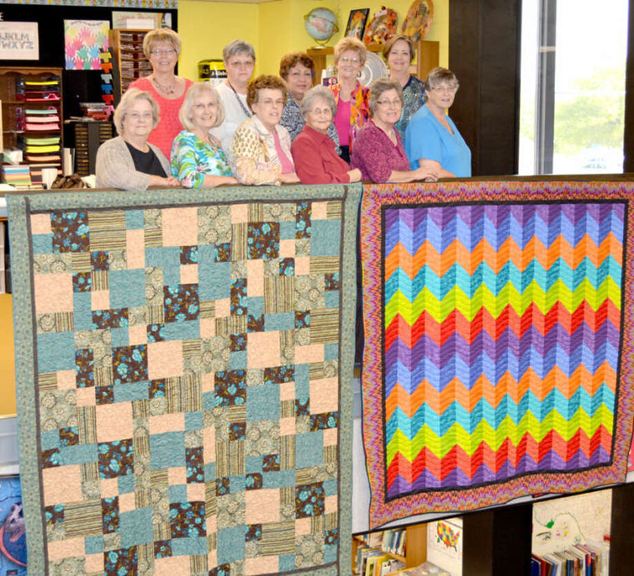 "Doug McDonough/Plainview HeraldFor the 30th consecutive year, Creative Quilters have a large selection of quilts on display at Unger Memorial Library. During the month of May, the group has 20 quilts hanging in the library with several more in display cases. Helping to place the quilts on display last week were Scharlene Chastain (front left), Barbara DeBerry, Nancy Richburg, Emma Rigsby, Joy McCulloch, Nita Reese, Barbara Lambert (back left), Ethelyn Garrett, Bertha Longaria, Phil Burns and Brenda Mangold. They are standing behind quilts titled ""My Kind of Blues,"" pieced by Barbara DeBerry and quilted by Betty Wells, and ""Corrugated-Corrugated,"" pieced and quilted by Joy McCulloch. Members of the group will be on hand from 9 a.m. to 2:30 p.m. Saturday to offer personal tours and answer questions concerning the art of quilting."