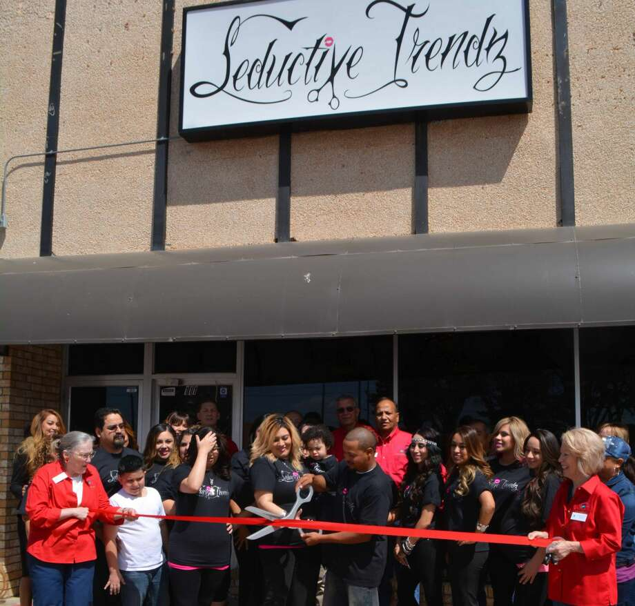 Owners Scott and Nancy Craft slice through a ribbon during a formal Chamber of Commerce Ambassadors ribbon cutting ceremony on April 11 at their new hair salon, Seductive Trendz, 111 E. Sixth. The business features a full service salon with several stylists on staff. Its phone number is 806-213-7777.