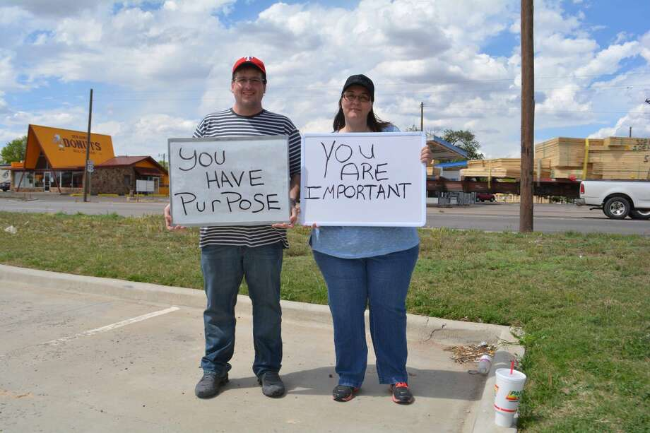 "Doug McDonough/Plainview Herald Cousins Danny Albright and Dawn Pringle of Amarillo spent several hours Thursday afternoon holding up signs showing the messages ""You Have Purpose"" and ""You Are Important"" as part of a personal ministry of encouragement throughout the region."