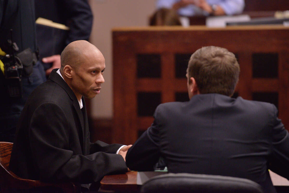 Dominique Green, the defendant in a capital murder trial, confers with his attorney at the start of the proceedings Tuesday morning in the 226th State District Court.