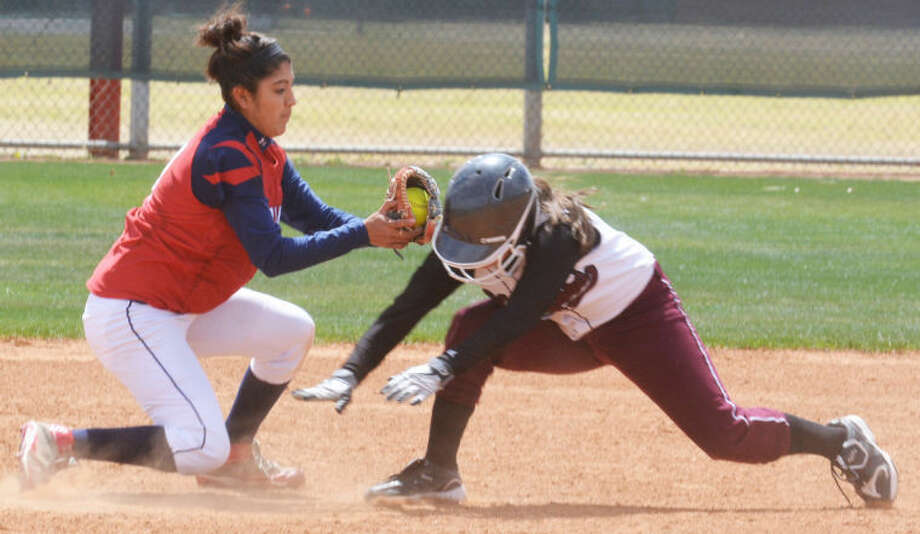 Plainview shortstop Averee DeLuna (left) tags out a Hereford runner during a softball game earlier this season. Heads-up defensive plays such as this will be necessary for the Lady Bulldogs to get past El Paso Chapin in the area round of the playoffs in Odessa Friday and Saturday. Photo: Skip Leon/Plainview Herald