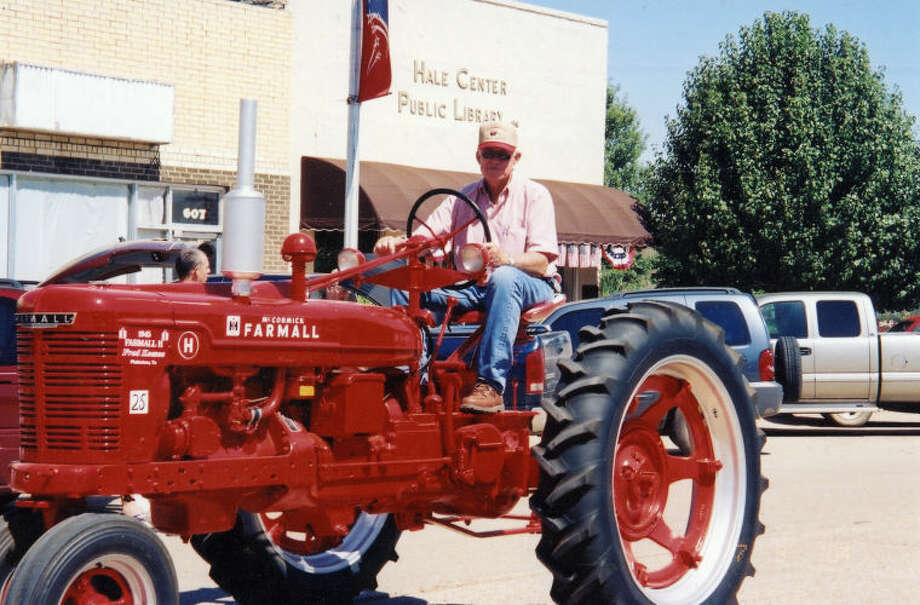 Courtesy PhotoThis year's 22nd Annual Antique Tractor Show, set for Saturday at the Hale County Farm and Ranch Museum, is dedicated to the late Fred Keesee,shown driving a restored Farmall tractor in a Hale Center parade.