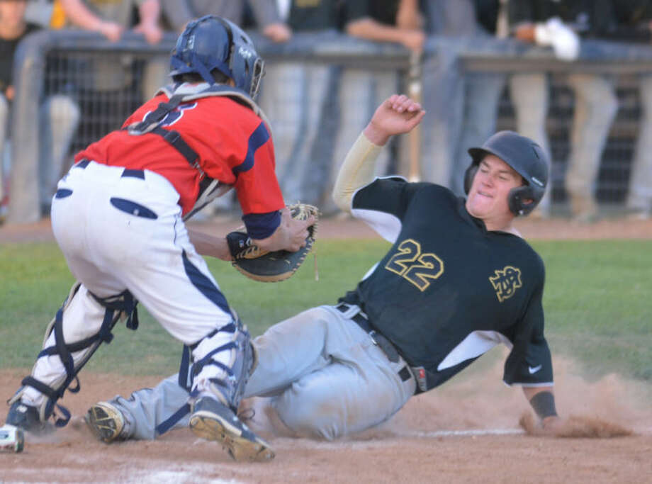 Plainview catcher Landon Cochran waits with the ball to tag out an Amarillo High runner at home plate in the seventh inning of a bi-district playoff game at Bulldog Park Thursday. Amarillo won the opener in the best-of-three series, 10-1. Game two is at 5 p.m. today at Sandie Field in Amarillo. Photo: Skip Leon/Plainview Herald
