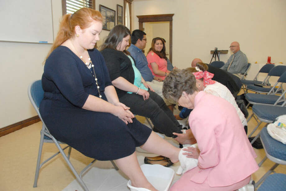 Jonathan Petty/Wayland Baptist UniversityWayland senior Hailey Budnick has her feet washed by Professor of Religion Dr. Carolyn Ratcliffe during a special ceremony held by the School of Religion and Philosophy.